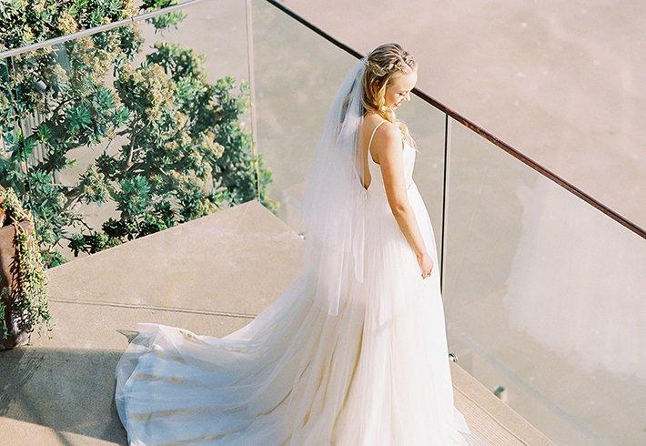 Bride on Balcony overlooking Sand