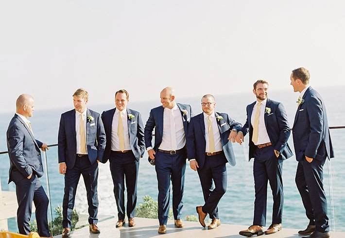 Grooms Men on the balcony over the Pacific Ocean at our wedding venue in Laguna Beach