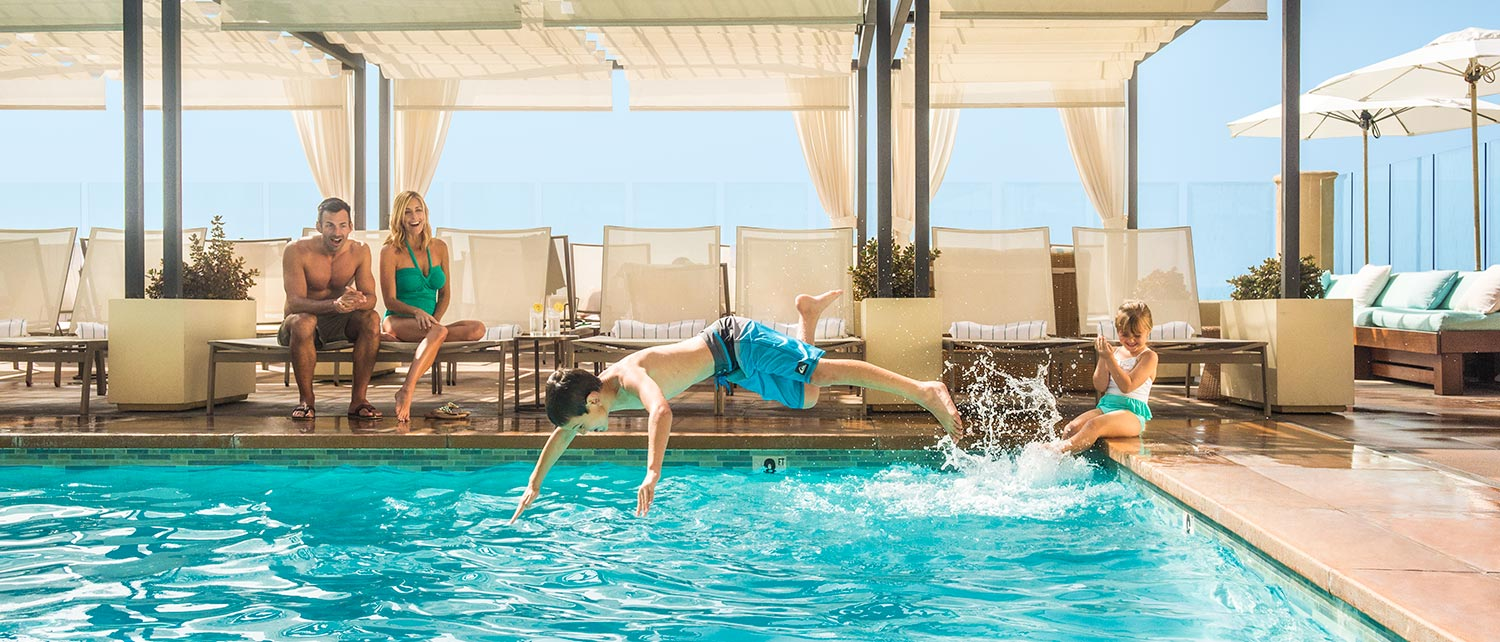Family at Surf & Sand Resort's Oceanfront Outdoor Pool in Laguna Beach