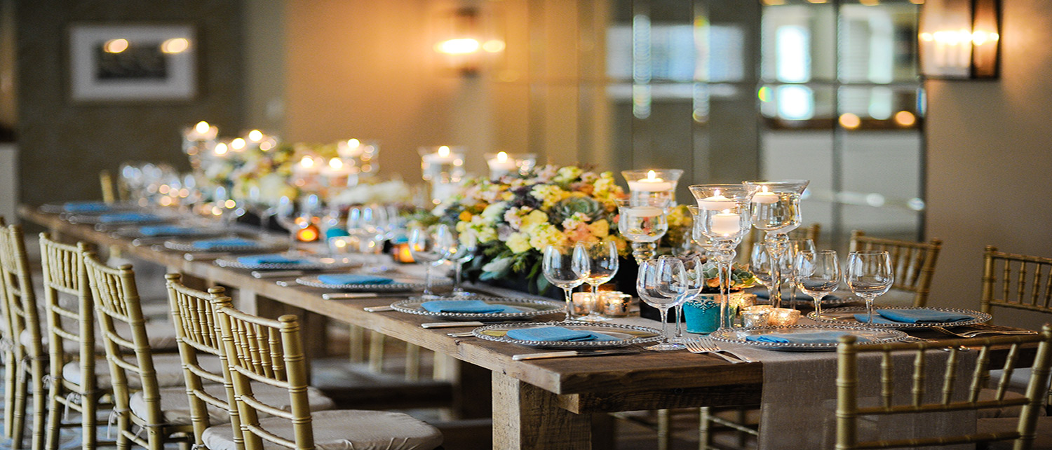 Surf & Sand Resort Event venue with long dining table