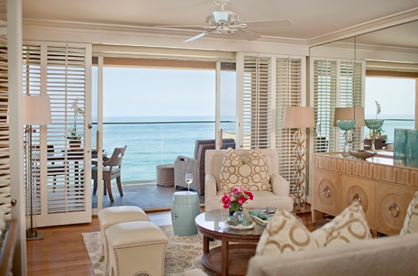 Light decor in our Laguna Beach Suite living room with doors open to the balcony