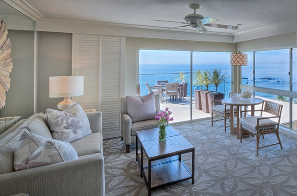 Our Resort in Laguna Beach corner room with patio overlooking ocean and deck table and chairs