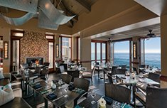 Splashes dining area with ocean views at Surf and Sand Resort