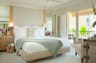 Surf and Sand Resort Penthouse suite with king and side tables including balcony with ocean views