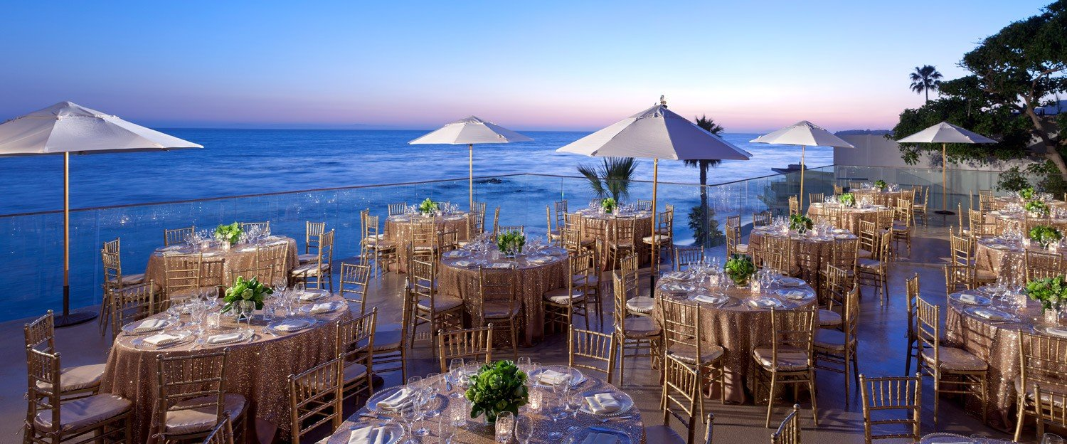 Table set up on the patio overlooking the beach at Surf and Sand