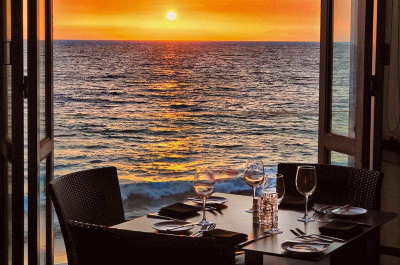 View of the sunset at Splashes Restaurant in Surf & Sand Resort