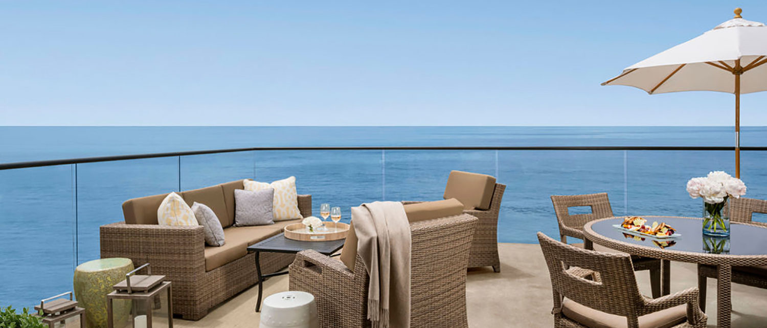 Surf and Sand patio overlooking the beach and ocean with plenty of seating