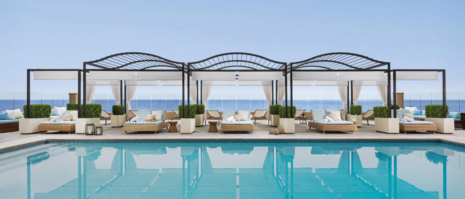 Five cabanas by the pool with shade, loungers and space at Surf and Sand Resort