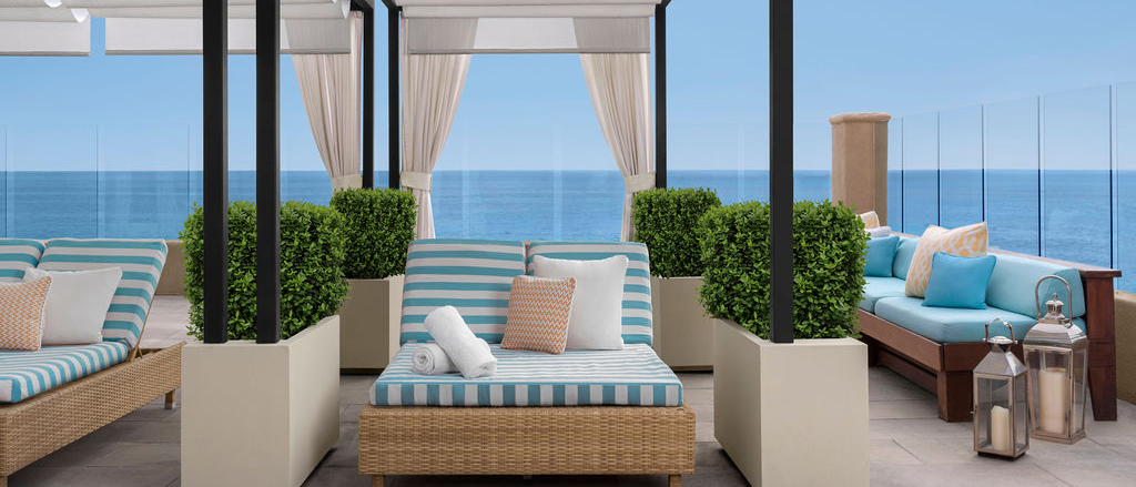 Stripped coushins on our laguna beach loungers by the pool at Surf and Sand