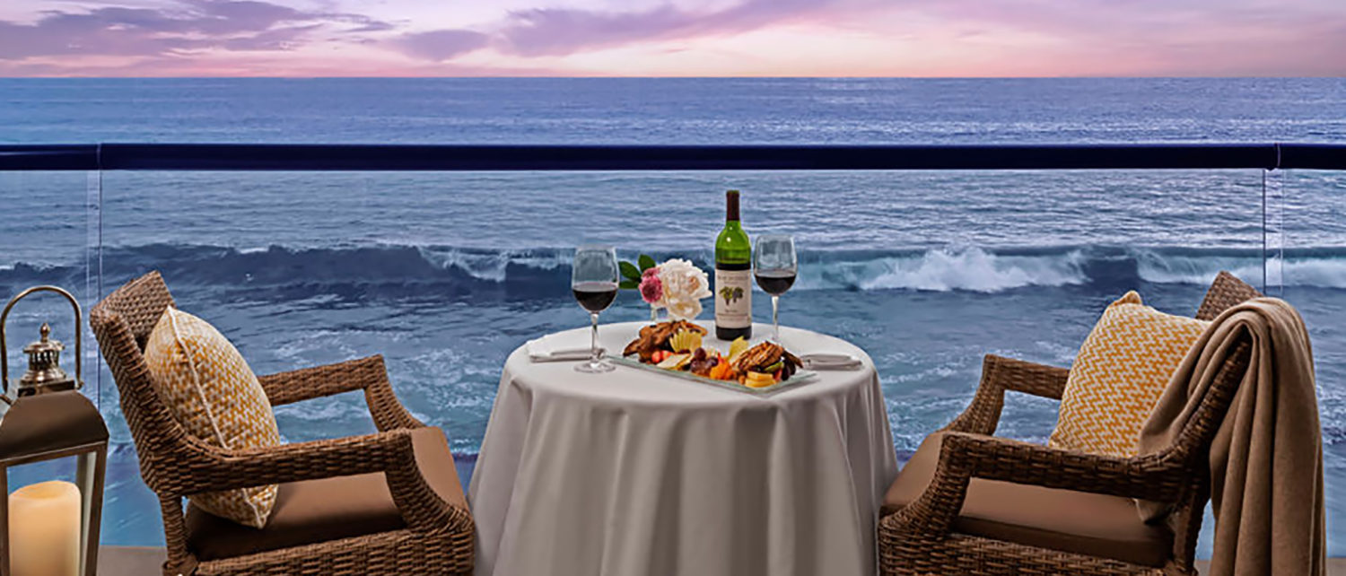 Two Chair, Two Glasses of wine, ocean views at dusk for two in Laguan Beach, Surf and Sand Resort